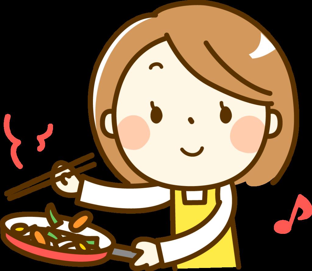 料理をしている女性の画像